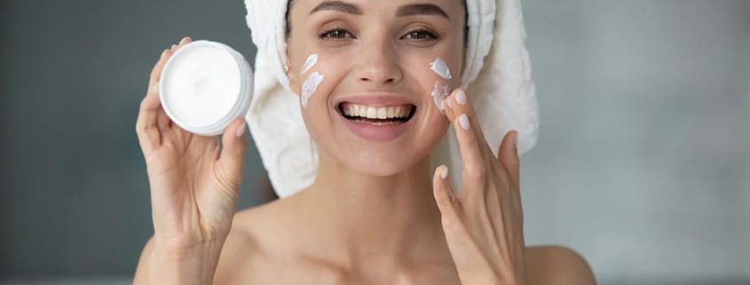 image of woman with towel and moisturizer